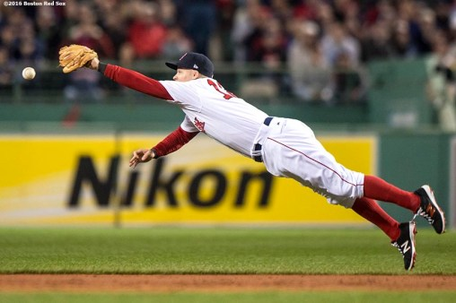 BOSTON, MA - OCTOBER 10: Brock Holt #12 of the Boston Red Sox dives for a line drive during the second inning of game three of the American League Division Series against the Cleveland Indians on October 10, 2016 at Fenway Park in Boston, Massachusetts. (Photo by Billie Weiss/Boston Red Sox/Getty Images) *** Local Caption *** Brock Holt