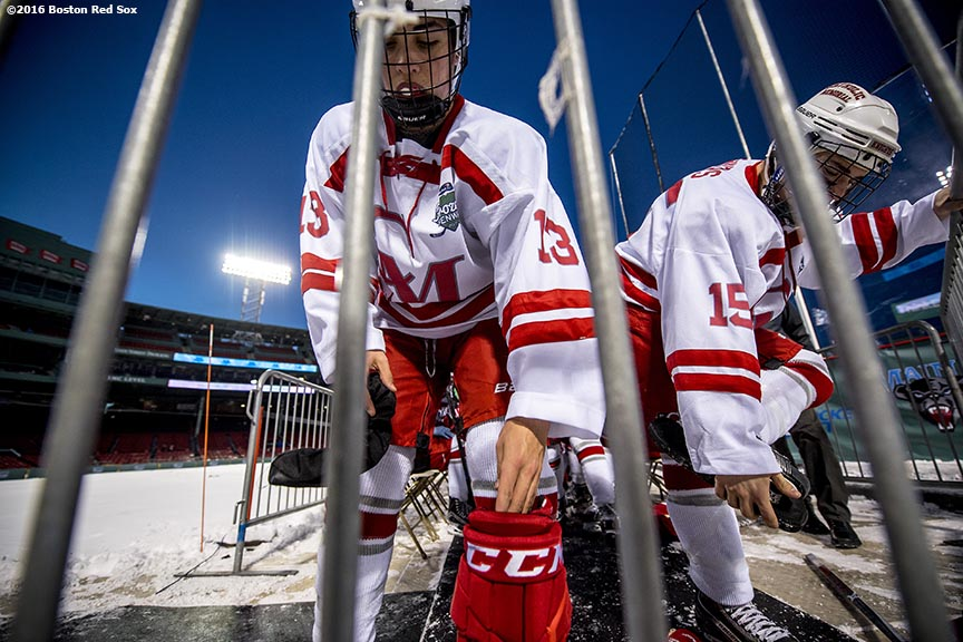 January 9, 2017, Boston, MA: Members of Catholic Memorial put protectors on their skates between periods of a game against BC High during Capital One Frozen Fenway 2017 at Fenway Park in Boston, Massachusetts Monday, January 9, 2017. (Photo by Billie Weiss/Boston Red Sox)
