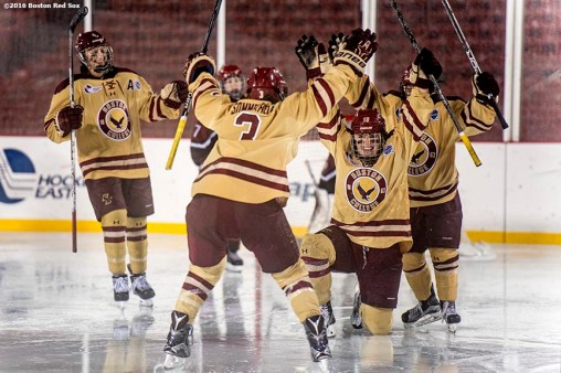 January 10, 2017, Boston, MA: Members Boston College react after scoring a goal during a game against Harvard during Capital One Frozen Fenway 2017 at Fenway Park in Boston, Massachusetts Tuesday, January 10, 2017. (Photo by Billie Weiss/Boston Red Sox)