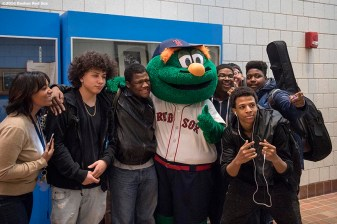 January 27, 2017, Boston, MA: Boston Red Sox mascot Wally the Green Monster poses for a photograph with students during a Jackie Robinson Day recognition event at Charlestown High School in Boston, Massachusetts Friday, January 27, 2017. (Photo by Billie Weiss/Boston Red Sox)