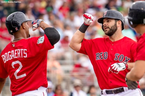 FT. MYERS, FL - FEBRUARY 23: Mitch Moreland #18 of the Boston Red Sox high fives Xander Bogaerts #2 after hitting a three run home run during the third inning of a game against Northeastern University on February 23, 2017 at Fenway South in Fort Myers, Florida . (Photo by Billie Weiss/Boston Red Sox/Getty Images) *** Local Caption *** Mitch Moreland; Xander Bogaerts