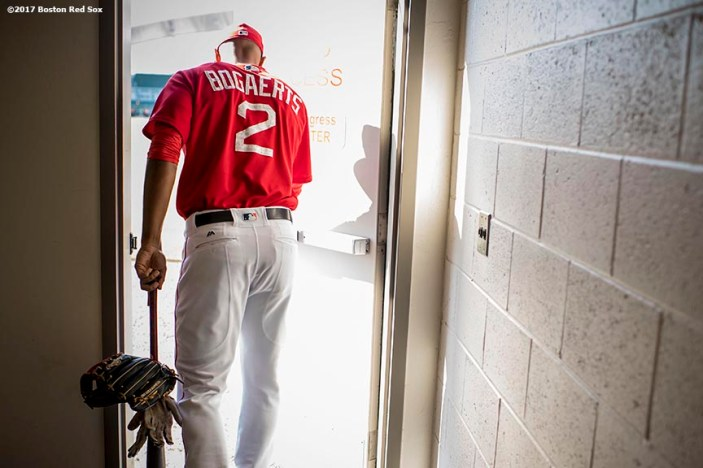FT. MYERS, FL - FEBRUARY 27: Xander Bogaerts #2 of the Boston Red Sox walks through a door onto the field before a Spring Training game against the St. Louis Cardinals on February 27, 2017 at Fenway South in Fort Myers, Florida . (Photo by Billie Weiss/Boston Red Sox/Getty Images) *** Local Caption *** Xander Bogaerts
