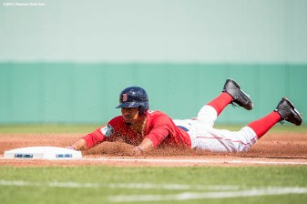 FT. MYERS, FL - FEBRUARY 27: Mookie Betts #50 of the Boston Red Sox slides into third base during the first inning of a Spring Training game against the St. Louis Cardinals on February 27, 2017 at Fenway South in Fort Myers, Florida . (Photo by Billie Weiss/Boston Red Sox/Getty Images) *** Local Caption ***