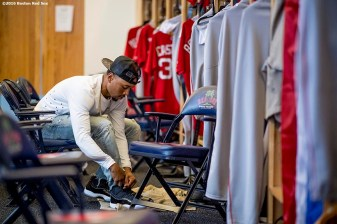FT. MYERS, FL - MARCH 2: Mookie Betts #50 of the Boston Red Sox ties his shoes as he gets dressed after a Spring Training game against the Tampa Bay Rays on March 2, 2017 at Fenway South in Fort Myers, Florida . (Photo by Billie Weiss/Boston Red Sox/Getty Images) *** Local Caption *** Mookie Betts