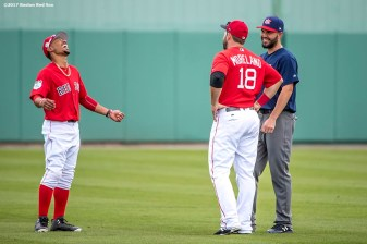 FT. MYERS, FL - MARCH 9: Mitch Moreland #18 and Mookie Betts #50 of the Boston Red Sox react with Eric Hosmer of Team USA before a Spring Training game on March 9, 2017 at Fenway South in Fort Myers, Florida . (Photo by Billie Weiss/Boston Red Sox/Getty Images) *** Local Caption *** Mitch Moreland; Eric Hosmer; Mookie Betts