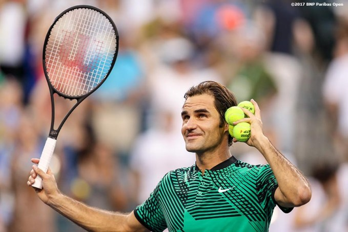 Roger Federer gestures as he hits tennis balls into the stands after defeating Rafael Nadal at the Indian Wells Tennis Garden in Indian Wells, California on Saturday, March 11, 2017. (Photo by Billie Weiss/BNP Paribas Open)