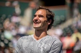 Roger Federer addresses the crowd after his opponent Nick Kyrgios retired from their upcoming match due to illness at the Indian Wells Tennis Garden in Indian Wells, California on Friday, March 17, 2017. (Photo by Billie Weiss/BNP Paribas Open)