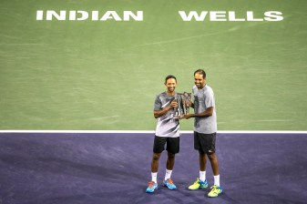 Raven Klaasen and Rajeev Ram pose with the trophy after winning the men's doubles final against Lukasz Kubot and Marcelo Melo at the Indian Wells Tennis Garden in Indian Wells, California on Saturday, March 18, 2017. (Photo by Billie Weiss/BNP Paribas Open)