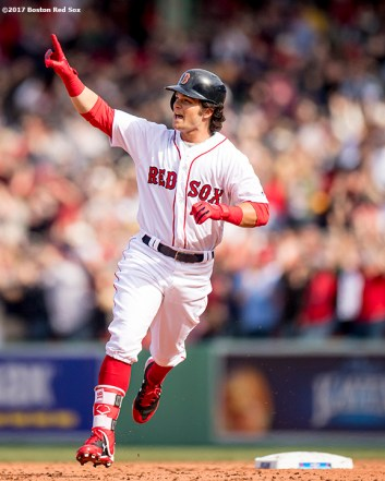BOSTON, MA - APRIL 3: Andrew Benintendi #16 of the Boston Red Sox reacts as he rounds the bases after hitting a three run home run during the fifth inning of the home opener against the Pittsburgh Pirates on April 3, 2017 at Fenway Park in Boston, Massachusetts. (Photo by Billie Weiss/Boston Red Sox/Getty Images) *** Local Caption ***Andrew Benintendi