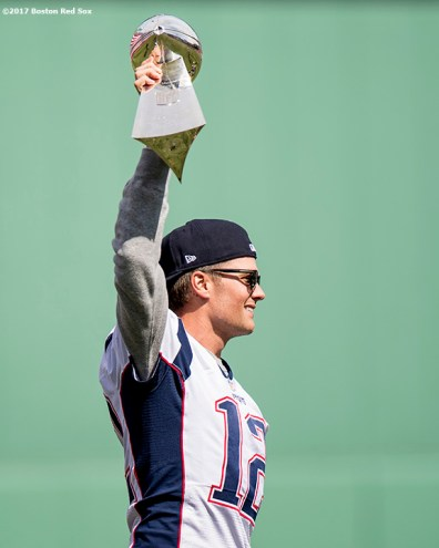 BOSTON, MA - APRIL 3: Tom Brady #12 of the New England Patriots holds the Super Bowl trophy during a pre-game ceremony before the Boston Red Sox home opener against the Pittsburgh Pirates on April 3, 2017 at Fenway Park in Boston, Massachusetts. (Photo by Billie Weiss/Boston Red Sox/Getty Images) *** Local Caption *** Tom Brady