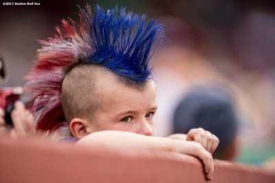 BOSTON, MA - APRIL 16: A young fan looks on during a game between the Boston Red Sox and the Tampa Bay Rays on April 16, 2017 at Fenway Park in Boston, Massachusetts. (Photo by Billie Weiss/Boston Red Sox/Getty Images) *** Local Caption ***