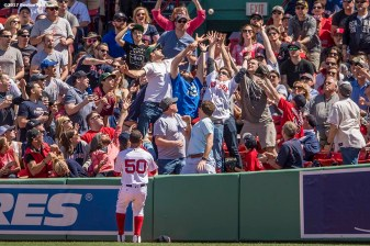BOSTON, MA - APRIL 17: Fans catch a ground rule double out of the reach of Mookie Betts #50 of the Boston Red Sox during the sixth inning of a game against the Tampa Bay Rays on April 17, 2017 at Fenway Park in Boston, Massachusetts. (Photo by Billie Weiss/Boston Red Sox/Getty Images) *** Local Caption *** Mookie Betts