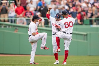 BOSTON, MA - APRIL 17: Andrew Benintendi #16, Mookie Betts #50, and Chris Young #30 of the Boston Red Sox celebrate a victory against the Tampa Bay Rays on April 17, 2017 at Fenway Park in Boston, Massachusetts. (Photo by Billie Weiss/Boston Red Sox/Getty Images) *** Local Caption *** Andrew Benintendi; Mookie Betts; Chris Young