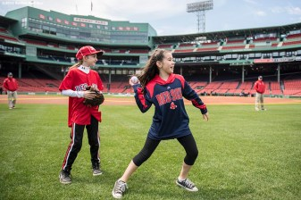 April 19, 2017, Boston, MA: Kids play during Little League Opening Day at Fenway Park in Boston, Massachusetts Wednesday, April 19, 2017. (Photo by Billie Weiss/Boston Red Sox)