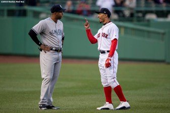 BOSTON, MA - APRIL 27: Mookie Betts #50 of the Boston Red Sox talks with Aaron Hicks #31 of the New York Yankees before a game on April 27, 2017 at Fenway Park in Boston, Massachusetts. (Photo by Billie Weiss/Boston Red Sox/Getty Images) *** Local Caption *** Aaron Hicks; Mookie Betts