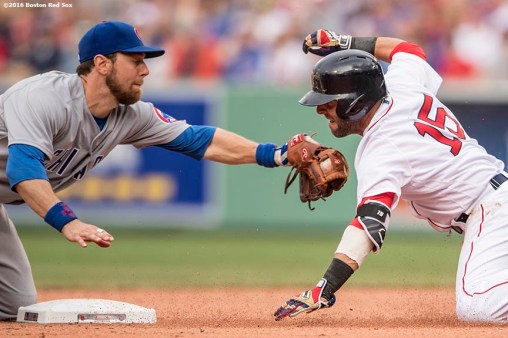 BOSTON, MA - APRIL 29: Dustin Pedroia #15 of the Boston Red Sox is tagged out by Ben Zobrist #18 of the Chicago Cubs at second base during the sixth inning of a game on April 29, 2017 at Fenway Park in Boston, Massachusetts. (Photo by Billie Weiss/Boston Red Sox/Getty Images) *** Local Caption *** Dustin Pedroia; Ben Zobrist