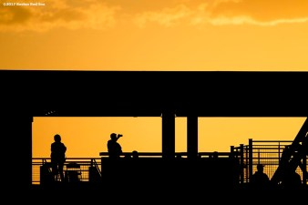 BOSTON, MA - MAY 2: A fan takes a photo of the sunset during a game between the Boston Red Sox and the Baltimore Orioles on May 2, 2017 at Fenway Park in Boston, Massachusetts. (Photo by Billie Weiss/Boston Red Sox/Getty Images) *** Local Caption ***