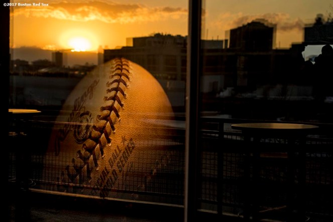 BOSTON, MA - MAY 2: The sunset is reflected in the window during a game between the Boston Red Sox and the Baltimore Orioles on May 2, 2017 at Fenway Park in Boston, Massachusetts. (Photo by Billie Weiss/Boston Red Sox/Getty Images) *** Local Caption ***