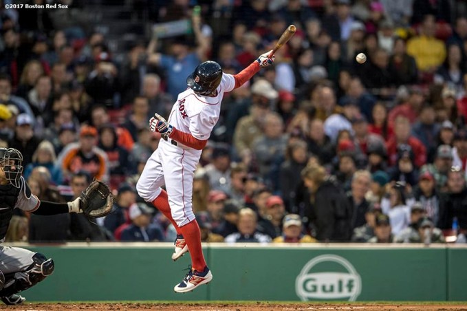 BOSTON, MA - MAY 3: Xander Bogaerts #2 of the Boston Red Sox is hit by Kevin Gausman #39 of the Baltimore Orioles during the second inning of a game on May 3, 2017 at Fenway Park in Boston, Massachusetts. (Photo by Billie Weiss/Boston Red Sox/Getty Images) *** Local Caption *** Xander Bogaerts