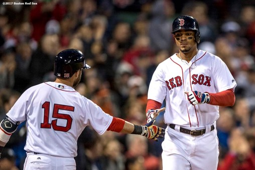 BOSTON, MA - MAY 3: Xander Bogaerts #2 high fives Dustin Pedroia #15 of the Boston Red Sox after scoring during the second inning of a game against the Baltimore Orioles on May 3, 2017 at Fenway Park in Boston, Massachusetts. (Photo by Billie Weiss/Boston Red Sox/Getty Images) *** Local Caption *** Xander Bogaerts; Dustin Pedroia