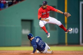 BOSTON, MA - MAY 12: Xander Bogaerts #2 of the Boston Red Sox turns a double play over Derek Norris #33 of the Tampa Bay Rays during the third inning of a game on May 12, 2017 at Fenway Park in Boston, Massachusetts. (Photo by Billie Weiss/Boston Red Sox/Getty Images) *** Local Caption *** Xander Bogaerts; Derek Norris