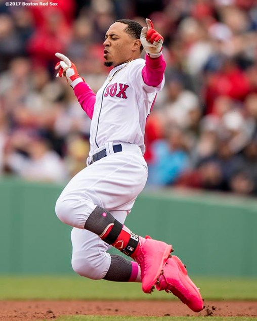 BOSTON, MA - MAY 13: Mookie Betts #50 of the Boston Red Sox slides after hitting an RBI double during the fifth inning of a game against the Tampa Bay Rays on May 13, 2017 at Fenway Park in Boston, Massachusetts. (Photo by Billie Weiss/Boston Red Sox/Getty Images) *** Local Caption *** Mookie Betts