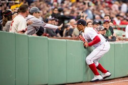 BOSTON, MA - MAY 23: Mookie Betts #50 of the Boston Red Sox runs into the wall after catching a fly ball during the first inning of a game against the Texas Rangers on May 23, 2017 at Fenway Park in Boston, Massachusetts. (Photo by Billie Weiss/Boston Red Sox/Getty Images) *** Local Caption *** Mookie Betts