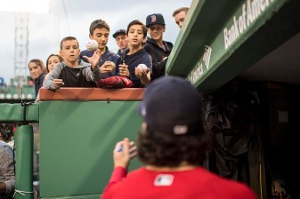 BOSTON, MA - MAY 26: Andrew Benintendi #16 of the Boston Red Sox signs autographs before a game against the Seattle Mariners on May 26, 2017 at Fenway Park in Boston, Massachusetts. (Photo by Billie Weiss/Boston Red Sox/Getty Images) *** Local Caption *** Andrew Benintendi