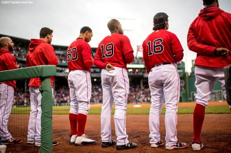 BOSTON, MA - MAY 26: Mookie Betts #50, Jackie Bradley Jr. #19, and Andrew Benintendi #16 of the Boston Red Sox stand for the National Anthem before a game against the Seattle Mariners on May 26, 2017 at Fenway Park in Boston, Massachusetts. (Photo by Billie Weiss/Boston Red Sox/Getty Images) *** Local Caption *** Mookie Betts; Andrew Benintendi; Jackie Bradley Jr.