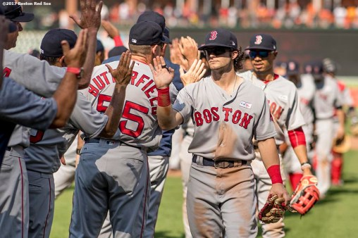 BOSTON, MA - JUNE 4: Andrew Benintendi #16 of the Boston Red Sox high fives teammates after a game against the Baltimore Orioles on June 4, 2017 at Oriole Park at Camden Yards in Baltimore, Maryland. (Photo by Billie Weiss/Boston Red Sox/Getty Images) *** Local Caption *** Andrew Benintendi