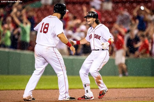 BOSTON, MA - JUNE 13: Andrew Benintendi #16 of the Boston Red Sox reacts with Mitch Moreland #18 after hitting a walk-off double to end the game against the Philadelphia Phillies on June 13, 2017 at Fenway Park in Boston, Massachusetts. (Photo by Billie Weiss/Boston Red Sox/Getty Images) *** Local Caption *** Andrew Benintendi; Mitch Moreland