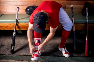 BOSTON, MA - JUNE 24: Brock Holt #12 of the Boston Red Sox puts on a shin guard before a game against the Los Angeles Angels of Anaheim on June 24, 2017 at Fenway Park in Boston, Massachusetts. (Photo by Billie Weiss/Boston Red Sox/Getty Images) *** Local Caption *** Brock Holt