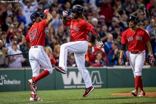 BOSTON, MA - JULY 14: Hanley Ramirez #13 of the Boston Red Sox reacts with Chris Young #30 and Xander Bogaerts #2 after hitting a two run home run during the third inning of a game against the New York Yankees on July 14, 2017 at Fenway Park in Boston, Massachusetts. (Photo by Billie Weiss/Boston Red Sox/Getty Images) *** Local Caption *** Hanley Ramirez; Xander Bogaerts; Chris Young