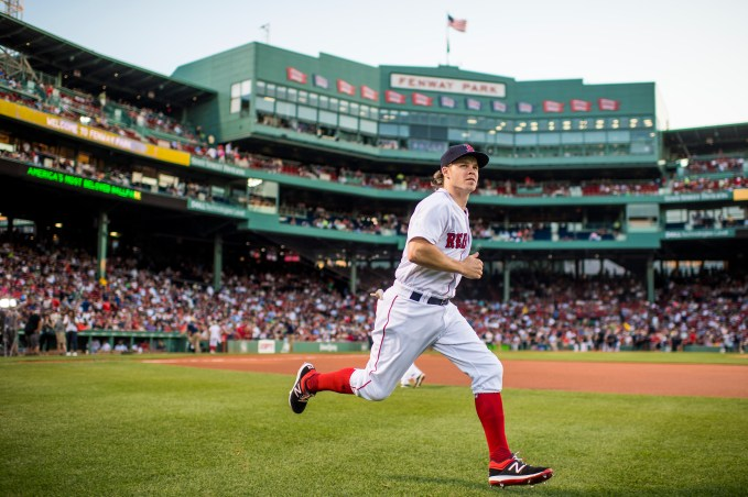 BOSTON, MA - JULY 16: Brock Holt #12 of the Boston Red Sox warms up before a game against the New York Yankees on July 16, 2017 at Fenway Park in Boston, Massachusetts. (Photo by Billie Weiss/Boston Red Sox/Getty Images) *** Local Caption *** Brock Holt