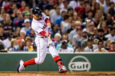 BOSTON, MA - JULY 16: Mookie Betts #50 of the Boston Red Sox hits a two run home run during the third inning of a game against the New York Yankees on July 16, 2017 at Fenway Park in Boston, Massachusetts. (Photo by Billie Weiss/Boston Red Sox/Getty Images) *** Local Caption *** Mookie Betts