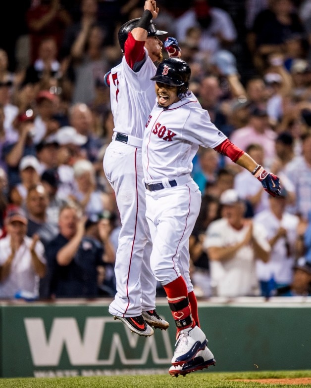 BOSTON, MA - JULY 16: Mookie Betts #50 of the Boston Red Sox reacts with Christian Vazquez after hitting a two run home run during the third inning of a game against the New York Yankees on July 16, 2017 at Fenway Park in Boston, Massachusetts. (Photo by Billie Weiss/Boston Red Sox/Getty Images) *** Local Caption *** Mookie Betts; Christian Vazquez
