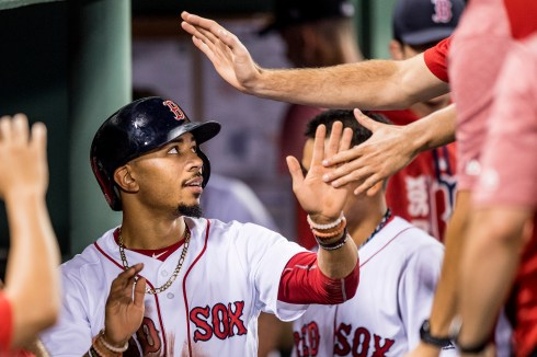 BOSTON, MA - JULY 16: Mookie Betts #50 of the Boston Red Sox high fives teammates after scoring during the sixth inning of a game against the New York Yankees on July 16, 2017 at Fenway Park in Boston, Massachusetts. (Photo by Billie Weiss/Boston Red Sox/Getty Images) *** Local Caption *** Mookie Betts