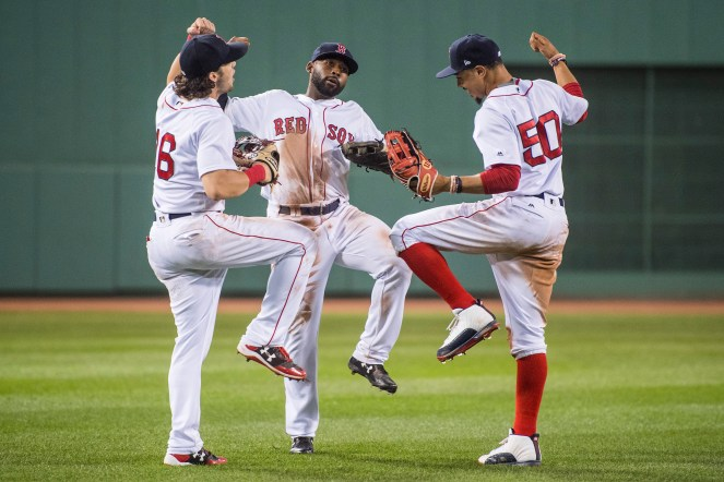 BOSTON, MA - JULY 16: Andrew Benintendi #16, Jackie Bradley Jr. #19, and Mookie Betts #50 of the Boston Red Sox celebrate a victory against the New York Yankees on July 16, 2017 at Fenway Park in Boston, Massachusetts. (Photo by Billie Weiss/Boston Red Sox/Getty Images) *** Local Caption *** Andrew Benintendi; Mookie Betts; Jackie Bradley Jr.