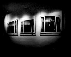 """Bill Jones, Landscape #4, 1971, silver prints, cut glass, 122 x 584 cm, 48"""" x 230"""". Installation view Trajectoire 73, Musee d'Art Moderne de la Ville de Paris."""