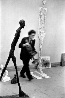 Henri Cartier-Bresson / Magnum Photos. Alberto GIacometti. The statue on the left is Walking Man