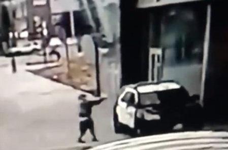BLM thug shoots through window