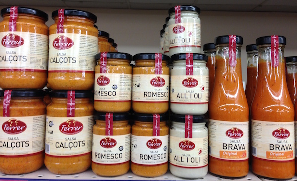 Different salsas on supermarket shelf in Barcelona.