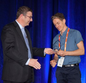 Receiving the award from BNHCRC CEO Richard Thornton