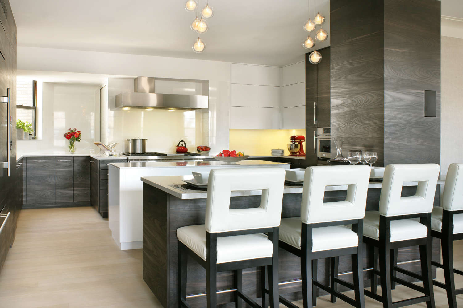 Contemporary kitchen offers a contrast in light and dark. Fully custom flat panel, frameless Artcraft Cabinetry in mix of pure white gloss and Yosemite Scuro laminate. Design by RitaLuisa Garces of Bilotta Kitchens.