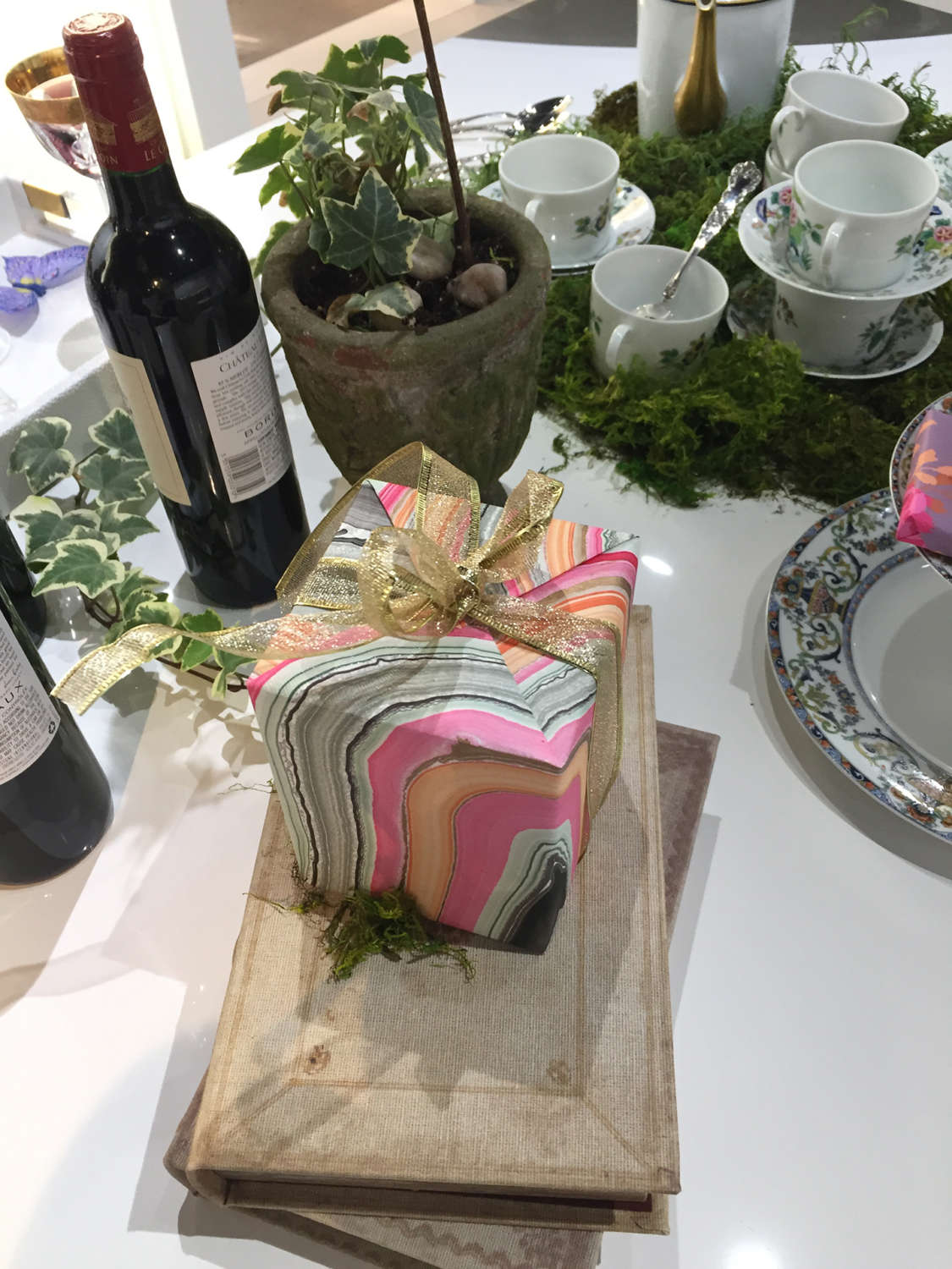 Wrapped gift, wine and ivy garlands at the Art of The Table.