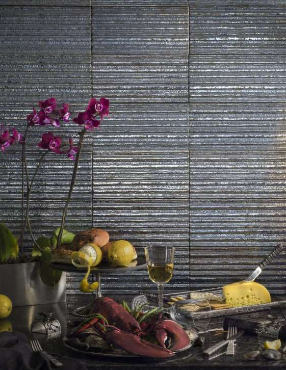 Ceramic tile embossed with bronze glass by Artistic Tile.