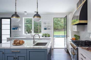 White kitchen gets a pop of color from a Benjamin Moore Blue Toile painted center island.