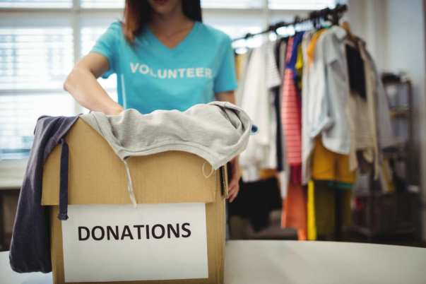 Volunteer Sorting through Donated Clothes