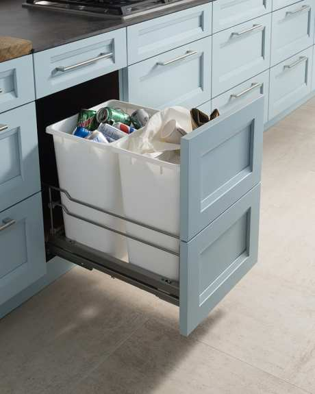 Pull-out trash and recycling bin in kitchen