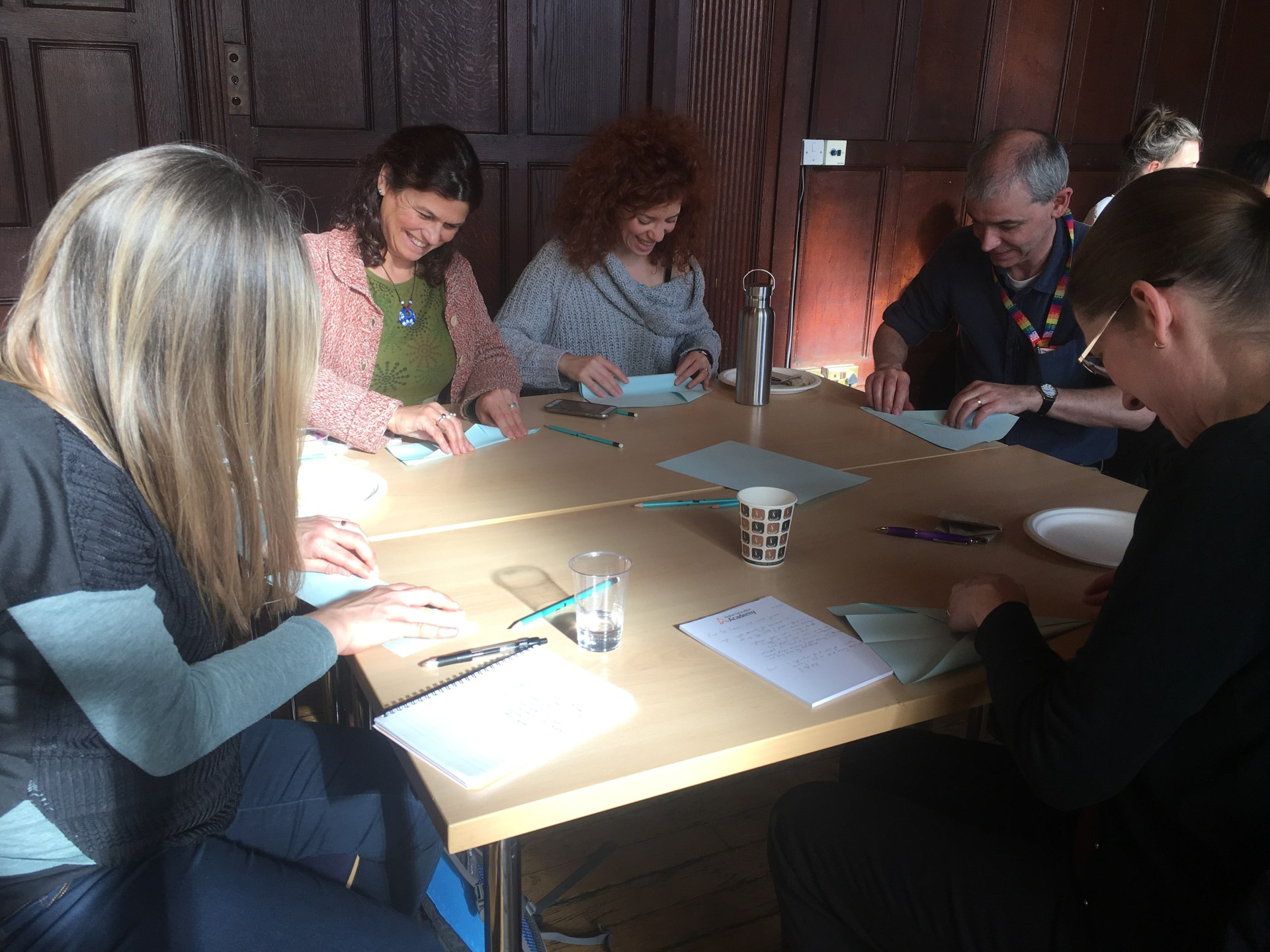 Staff sat at a table at the using games in teaching event